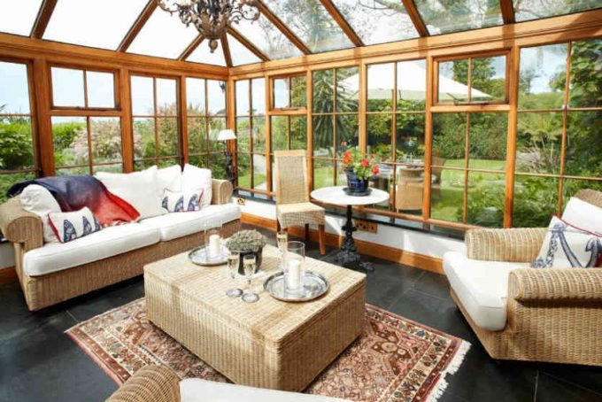 Large and spacious conservatory with doors outside